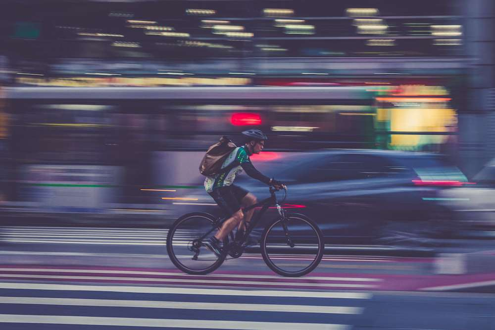 biker riding through Los Angeles streets who might need a bike accident attorney