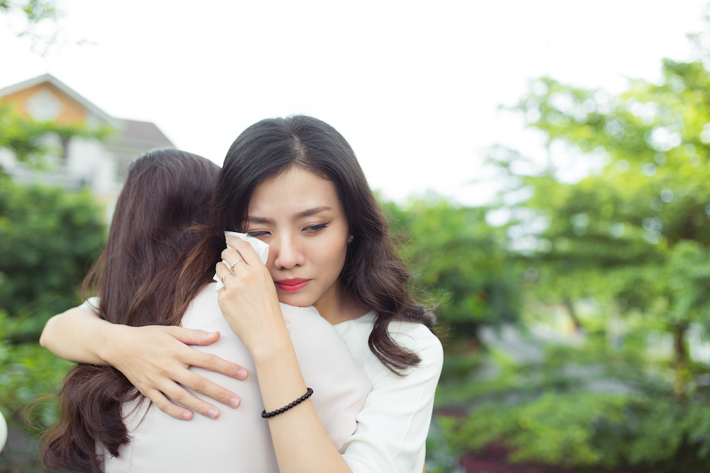 Woman hugging her friend after calling her sexual assault attorney to discuss her sexual assault case