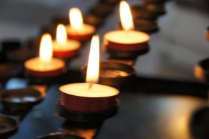 Candle vigil being held for victim of wrongful death before funeral