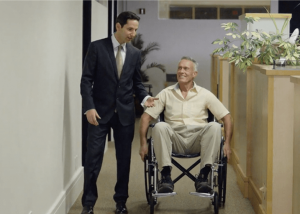 medical malpractice lawyer with a client in wheelchair