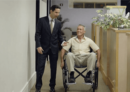 lawyer with a client in wheelchair
